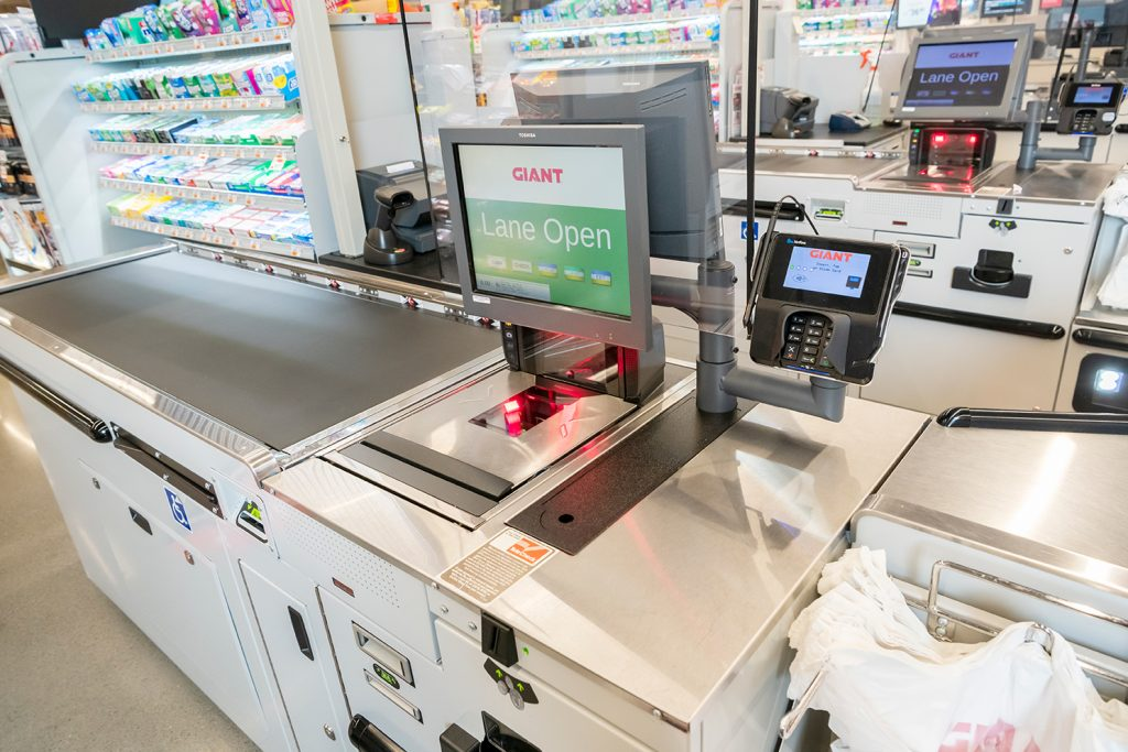 Close-Up View of Sliding POS Stands on Convertible lane